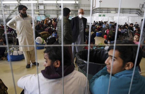 Afghan refugees at U.S. airbase in Germany during visit by Secretary of State Blinken.
