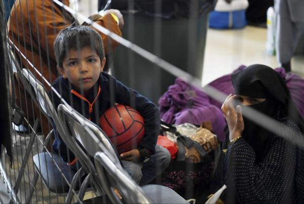 Afghan child waits to enter US